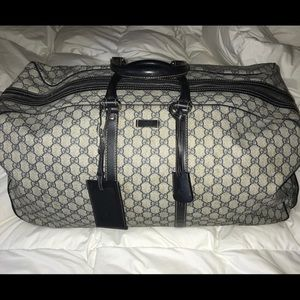 Rolling Gucci coated canvas duffle !!!